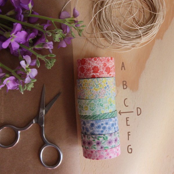 A duplicate photo of the rolls of washi tape with each color/pattern labeled with a brown letter.