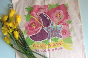 Another styled photo with daffodils on top of the bag, showing the design again.