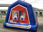 Bouncy castle with a smiley face on the front.