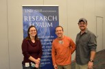 Raegen Pietrucha and Dr. Brian Hedlund pose in front of the Research Forum banner.
