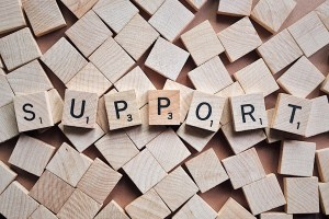 """Wooden blocks spelling the word """"support"""""""
