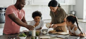 A family in the kitchen having breakfast