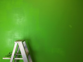 painted walls in green and a ladder