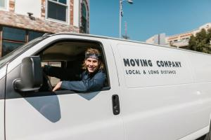 man in a moving truck helping someone move in second home in West Hollywood