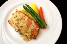 Grilled Salmon with Saffron Herb Rice, Sun-Dried Tomato Dill Butter Sauce