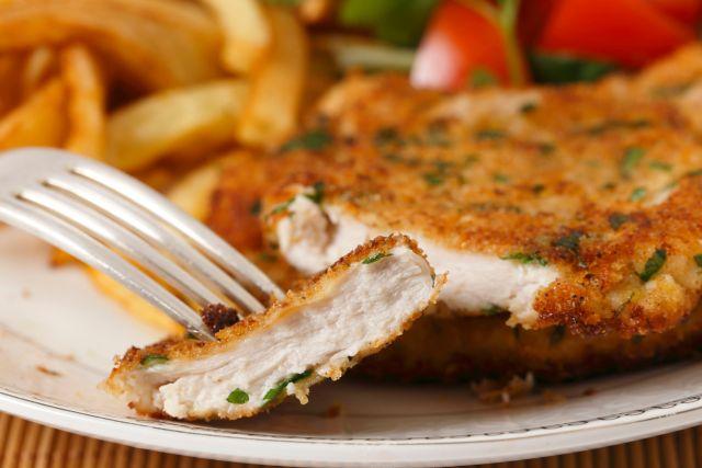 Chicken schnitzel sliced closeup