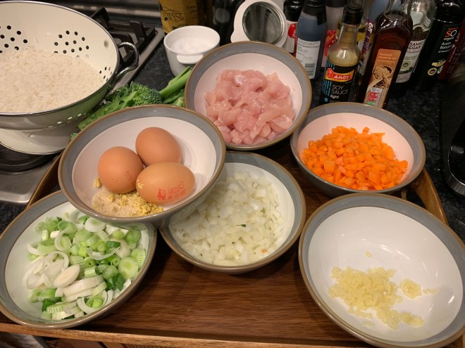 Fried rice ingredients prepared in bowls on a tray ready for cooking