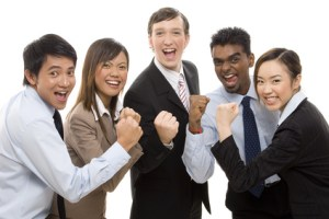 A group of business people celebrate their team success