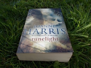 A copy of Runelight lies on grass