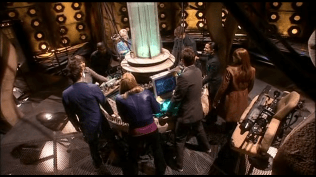 The Tenth Doctor, Donna, Martha Jones, Jack Harkness, Jackie Tyler, Mickey, Sarah-Jane Smith, the Metacrisis Doctor, and Rose Tyler stand around the TARDIS console, flying her.