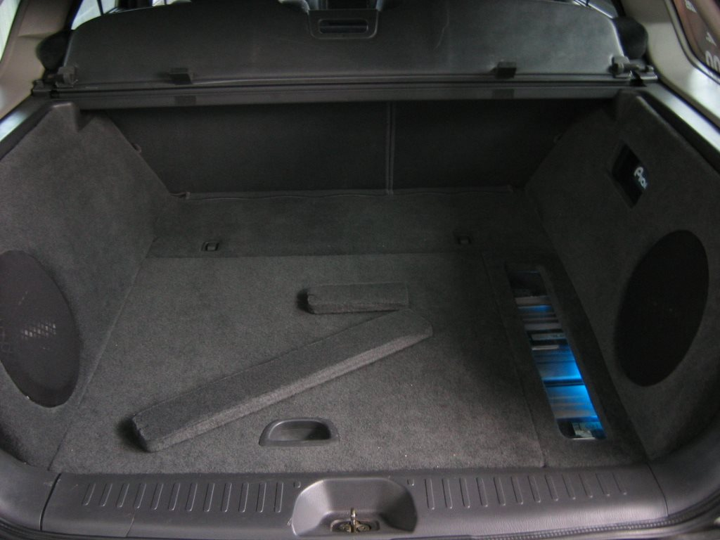 Custom Hideaway Boot Install - Note the Amplifiers