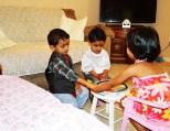 Tisha tying Rakhi on his brother wrist