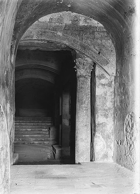 "Chamber, column and staircase under the al Aqsa mosque. ""Ancient entrance to the Temple,"" according to the Library of Congress caption (1927)"
