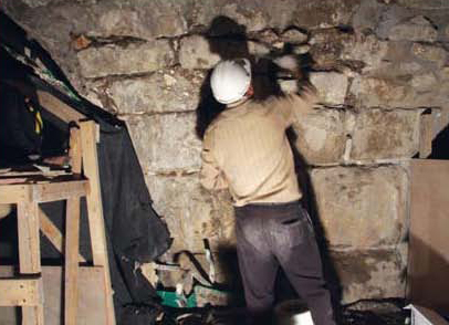 Reinforcement operations for existing recesses that were uncovered at the Western Wall Tunnel compound.