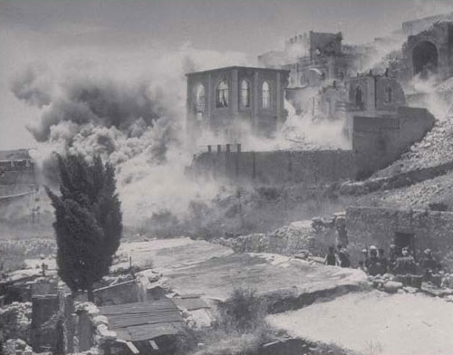 During 1948 synagogues and religious academies come under attack in the Old City of Jerusalem and are shelled by the artillery of the Arab Legion. Here, the Porat Yosef Yeshiva is destroyed. (Phillip John, Getty Images, 1948) - Defending Israel's Legal Rights to Jerusalem