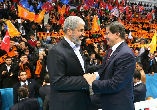 Turkish Prime Minister Ahmet Davutoğlu (R) and Hamas leader Khaled Mashaal greet each other during a AK Party congress in Konya on Saturday - Hamas' New Base in Turkey