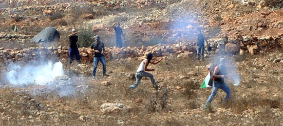 Violent rioters throwing rocks