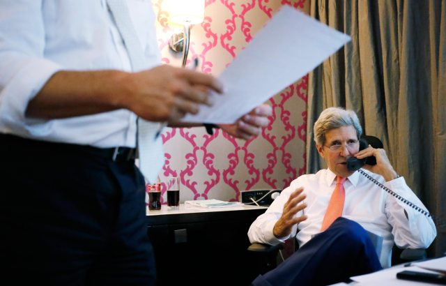 U.S. Secretary of State John Kerry speaks to Israeli Prime Minister Benjamin Netanyahu on July 25, 2014, from his hotel suite in Cairo, Egypt, about the terms of a ceasefire between Israel and Hamas in Gaza. (AP/Charles Dharapak)