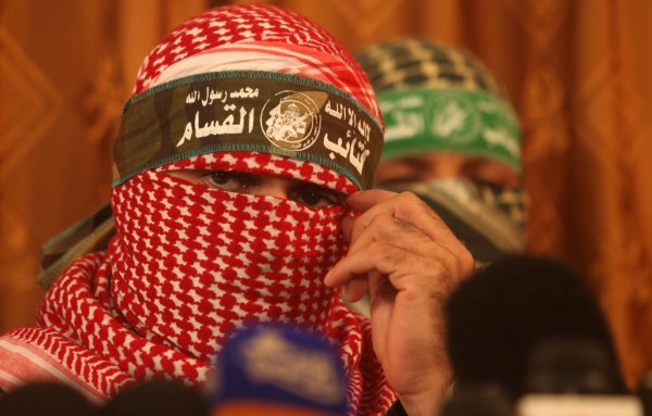 Hamas spokesman Abu Obeida speaks to the media on July 3, 2014, in Gaza City. (Sipa/Majdi Fathi)