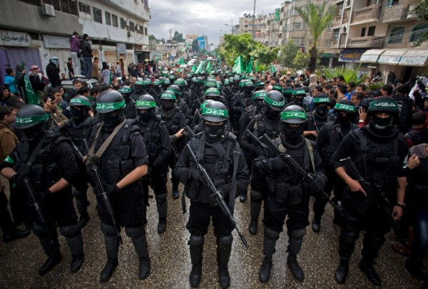 Hamas terrorists march in Gaza City on Dec. 14, 2014, to commemorate the 27th anniversary of the group's founding. (AP/Khalil Hamra)