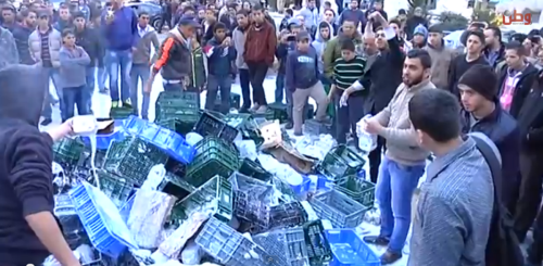 Palestinians destroy a truckload of Israeli milk products in Ramallah (YouTube)