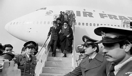Ayatollah Khomeini arrives in Iran in 1979 ending his exile in France.