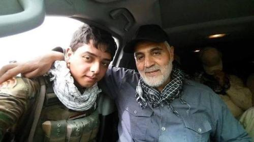 Iranian Revolutionary Guard-Qods Force Commander Gen. Qassem Suleimani with Shiite militia fighter in Iraq.