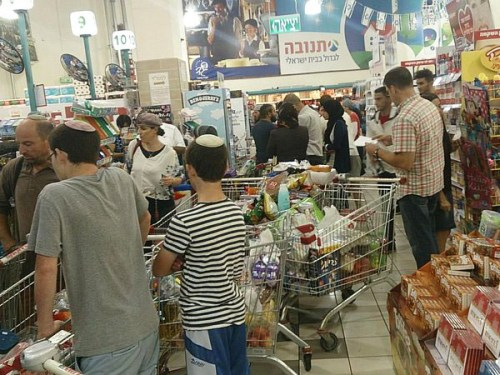 Jewish and Arab shoppers in the Etzion Bloc supermarket