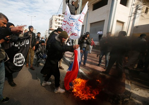 Salafists in the Hamas-controlled Gaza Strip burn a French flag