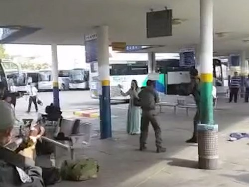 Arab woman brandishing a knife in the Afula bus station