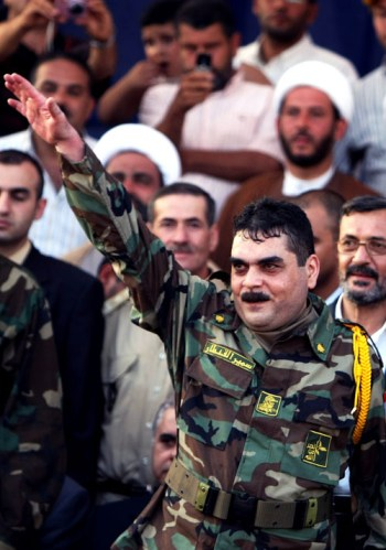 Samir Kantar, wearing Hezbollah military fatigues, gestures as he arrives to Naqura in southern Lebanon on July 16, 2008.