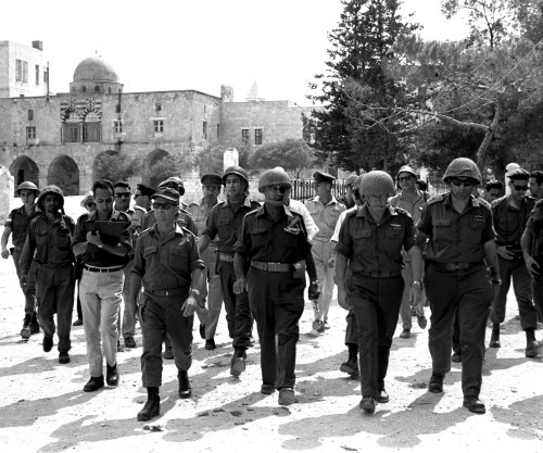 Defense Minister Moshe Dayan (center) visits the Temple Mount after its capture, June 7, 1967. Accompanying him (from right to left) Gen. Rehavam Zeevi, Chief of Staff Yitzhak Rabin, Dayan, and Gen. Uzi Narkis. Future president Chaim Herzog is in the third row, center.  (Ilan Bruner, Israel Government Press Office)