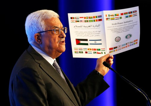 Don't hold on so tight.  Palestinian Authority President Mahmoud Abbas promoted the Arab Peace Initiative during a speech in Jordan, May 26, 2013. (AP Photo/Pool, Jim Young)