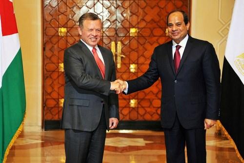 Egypt's President Abdel-Fatah El-Sisi (right) greets King Abdullah II of Jordan