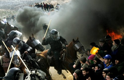 Settlement supporters clash with Israeli security forces during the evacuation of the Amona outpost in 2006.