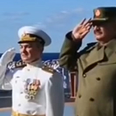Field Marshal Khalifa Haftar (right) on board the Russian aircraft carrier