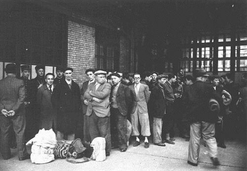 French police escort Jewish men to deportation trains at the Austerlitz station. Paris, France.