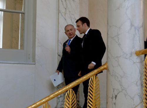 President Emmanuel Macron greets Prime Minister Benjamin Netanyahu