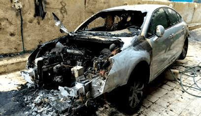 Dajani's Citroen after it was torched by denormalization activists
