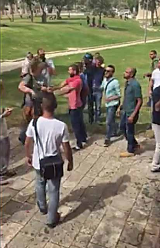 """Palestinian denormalization activist pushing a participant in the """"Jerusalem Hug"""" event"""