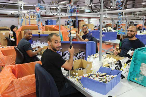 SodaStream workers assembling parts
