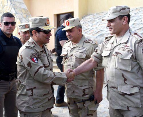 President el-Sisi in uniform meeting officer in the Sinai.