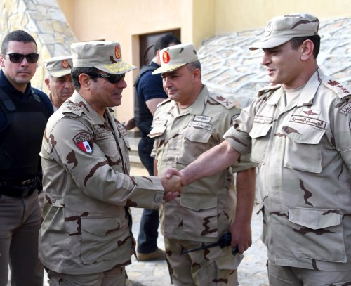 President el-Sisi in uniform meeting officer in the Sinai.