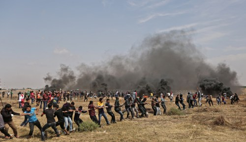 "Palestinian ""protesters"" trying to dismantle the Gaza-Israel border fence"
