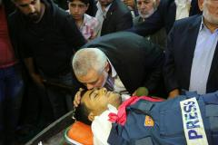 Hamas leader Ismail Haniyeh at the funeral of a Palestinian photographer killed in Gaza