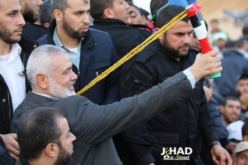 Ismail Haniyeh, shooting his sling shot at Israeli soldiers