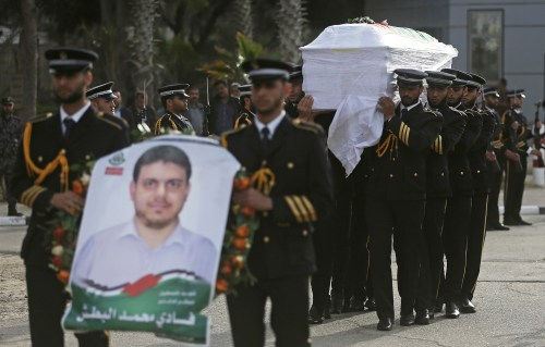 Members of Hamas' honor guard carry the coffin of Fadi al-Batsh.