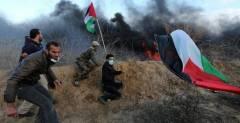 Hamas operatives at the border fence with Israel