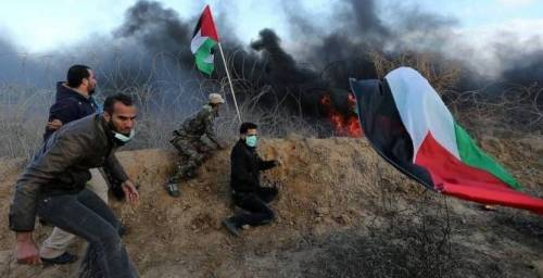 Hamas operatives at the border fence with Israel