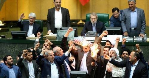 Iranian members of Parliament burning the American flag